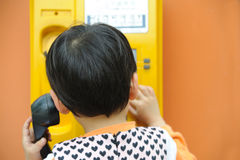 Chinese children make a telephone call Stock Image