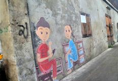 Chinese children painting on wall in old Chinese community village Stock Photography