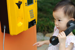 Chinese children with phone Royalty Free Stock Image