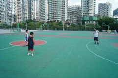 Chinese children play basketball with their father. Royalty Free Stock Photography
