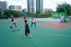 Chinese children play basketball with their father. Royalty Free Stock Image