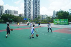 Chinese children play basketball with their father. Royalty Free Stock Photo