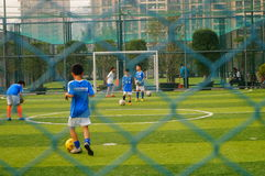 Chinese children are playing football Stock Image
