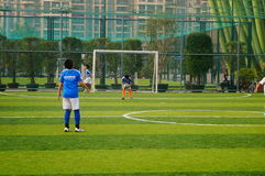 Chinese children are playing football Royalty Free Stock Image