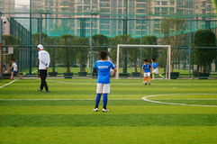 Chinese children are playing football Royalty Free Stock Photography