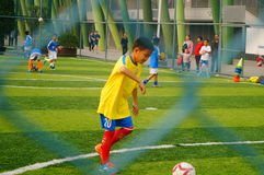 Chinese children are playing football Stock Photography