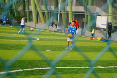 Chinese children are playing football Royalty Free Stock Images