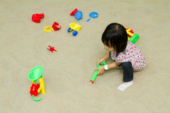Chinese children playing at indoor sandbox. Stock Image