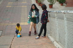Chinese children playing on the sidewalk Royalty Free Stock Image