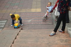 Chinese children playing on the sidewalk Stock Images