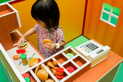 Chinese children role-playing at burger store. Stock Photos