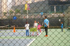 Chinese children in the training of tennis. Chinese children training tennis in Shenzhen, china stock images