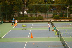 Chinese children in the training of tennis. Chinese children training tennis in Shenzhen, china stock photos