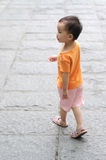 Chinese children walking on the road Royalty Free Stock Photos