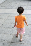 Chinese children walking on the road Royalty Free Stock Photo