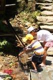 Chinese children wash hands in bamboo water drain stock photos