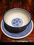 Chinese china Rice Bowl and Dish. A Chinese traditional china dinner bowl and dish with blue pattern on a wooden desk royalty free stock photography