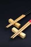 Chinese chop sticks on a black background Royalty Free Stock Image