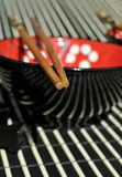 Chinese chopsticks. Detailed image of a chinese chopsticks and tableware Royalty Free Stock Photo