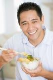 chinese chopsticks enjoying food man Στοκ εικόνες με δικαίωμα ελεύθερης χρήσης