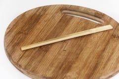 Chinese chopsticks on the kitchen cutting board Stock Photo