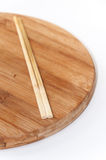 Chinese chopsticks on the kitchen cutting board Royalty Free Stock Photography