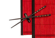 Chinese chopsticks on red bamboo mat. Asian style Royalty Free Stock Photography