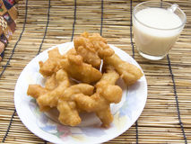 Chinese Churros. Delicious Asia, Asian eating food. Frying mini Chinese Churros or Chinese Donut in a white plate and soy milk for breakfast menu. The Thai name Royalty Free Stock Photography