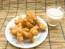 Chinese Churros. Delicious Asia, Asian eating food. Frying mini Chinese Churros or Chinese Donut in a white plate and soy milk for breakfast menu. The Thai name Stock Image