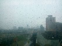 Chinese city building rains outside the window stock image