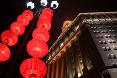 The Chinese city in New year. The traditional red lanterns decorating modern skyscrapers, in the Chinese city in New year stock photos