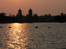Chinese City at Sunset. Outine of pagodas against the sky Royalty Free Stock Photo