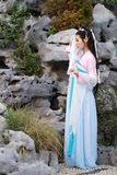 Chinese classic beauty in traditional ancient drama costume stand by rockery Stock Images
