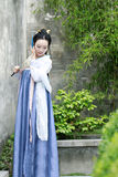Chinese classic beauty in traditional Hanfu dress enjoy free time Royalty Free Stock Photos