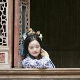 Chinese classic woman in Hanfu dress enjoy free time Stock Image
