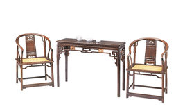 Chinese classical furniture  of Ming-style. Armchairs and narrow table.They are made by Red sandalwood,or Zitan in chinese Royalty Free Stock Photos