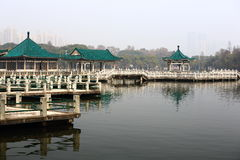 Chinese classical garden architecture. In East Lake in wuhan, China, with bridge and glazed tiles royalty free stock photography