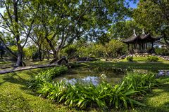 Chinese classical garden with pavilions and pond Royalty Free Stock Photos