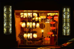 Chinese classical  lightings  In a lighting shop,Commercial lighting,  Home Furnishing lamp. Styles of chinese  lighting ,On the wallpaper China words are dragon Royalty Free Stock Image