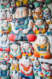 Chinese clay figurines on the wall Stock Image