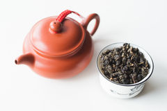 Chinese clay teapot and bowl with tea on a white background Stock Image