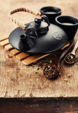 Chinese clay teapot and dry tea Royalty Free Stock Images