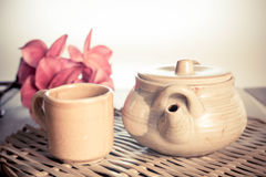 Chinese clay teapot with glass cup Stock Photography