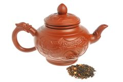 Chinese clay teapot, handful of green tea isolated Stock Photography