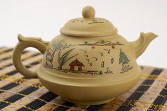 Chinese clay teapot. Chinese traditional clay teapot on bamboo mat Stock Photography