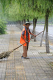A chinese cleaner is sweeping street Royalty Free Stock Photos