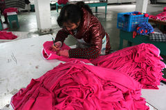 Chinese clothes factory with seamstresses Stock Images