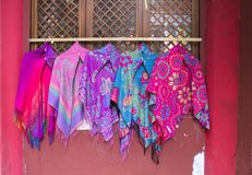 Chinese clothes hanging on the wall stock image