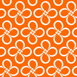Chinese Cloverleaf knot seamless pattern. Hand-drawn. White knots  on bright orange background. Vector illustration. Stock Image