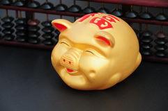 Chinese Coin or piggy bank with Chinese abacus Stock Photo
